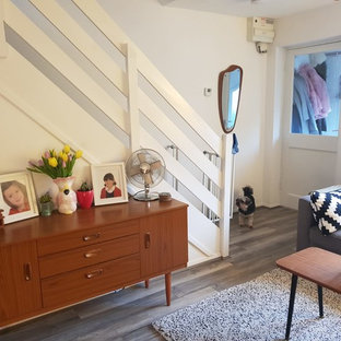 Entryway - small scandinavian bamboo floor and brown floor entryway idea in Hertfordshire with white walls and a white front door