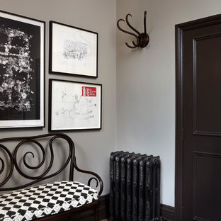 Ornate foyer photo in London with gray walls