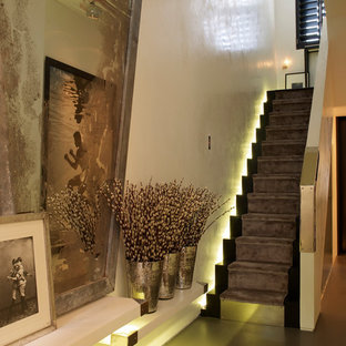 Example of a trendy foyer design in London with white walls