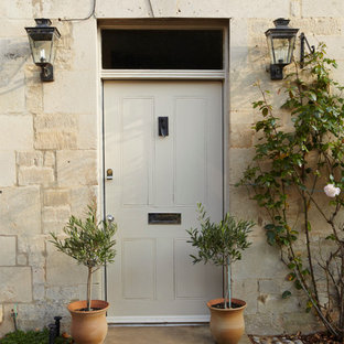 Inspiration for a rural front door in Dorset with a single front door.
