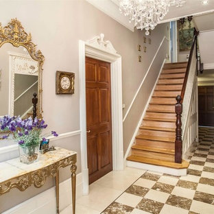 Medium sized traditional entrance in Hertfordshire with beige walls and marble flooring.