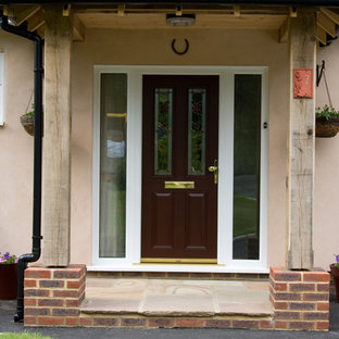 This is an example of a contemporary entrance in Kent with a brown front door.