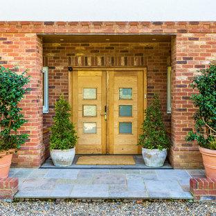 Contemporary front door in Surrey with a double front door, a light wood front door and grey floors.