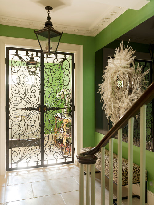 Mid Sized Eclectic Travertine Floor Entryway Photo In London With Green  Walls And A Metal