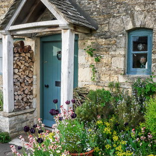 Inspiration for a country entryway remodel in Oxfordshire with a blue front door and gray walls