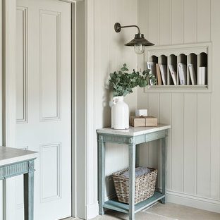 Photo of a classic entrance in Wiltshire with grey walls and beige floors.