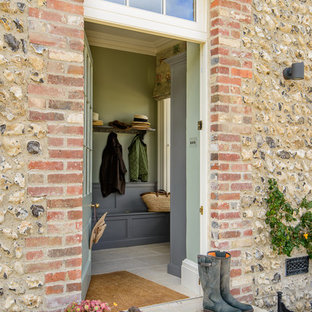 This is an example of a farmhouse front door in Other with green walls, a single front door and a grey front door.