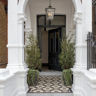 Inspiration for a classic front door in London with a single front door and a black front door.