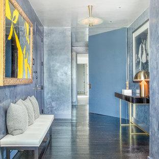 Entryway - contemporary dark wood floor and brown floor entryway idea in New York with blue walls and a blue front door