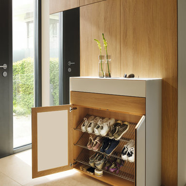 with made-to-order cabinets with hidden coat racks, shoe cabinets ...