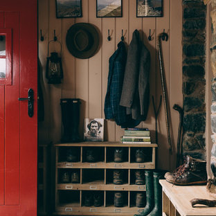 Photo of a medium sized traditional boot room in London with pink walls, slate flooring, a single front door, a red front door and grey floors.