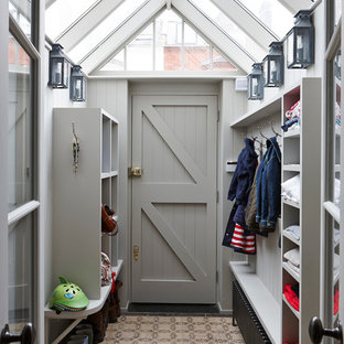 Inspiration for a transitional entryway remodel in London with a gray front door