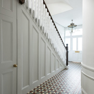 This is an example of a medium sized classic entrance in London with white walls, ceramic flooring and multi-coloured floors.