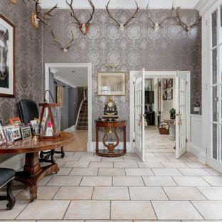 Example of an eclectic beige floor entryway design in Other with metallic walls and a glass front door