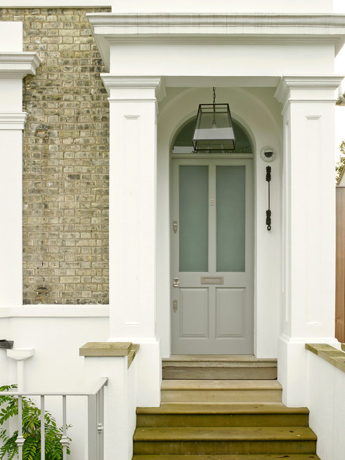 Example Of An Ornate Entryway Design In London With A Gray Front Door Part 38