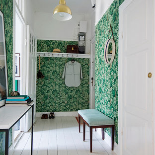 Inspiration for a mid-sized transitional mudroom in Stockholm with multi-coloured walls, painted wood floors, a single front door and a white front door.
