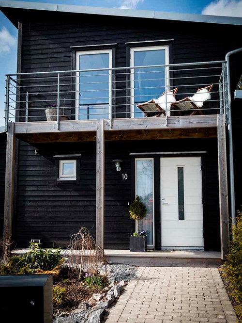 entr e scandinave avec un mur noir photos et id es d co d 39 entr es de maison ou d 39 appartement. Black Bedroom Furniture Sets. Home Design Ideas