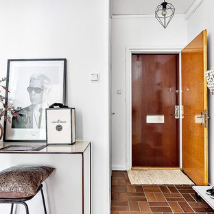 Inspiration for a medium sized scandinavian hallway in Stockholm with white walls, medium hardwood flooring, a single front door and a light wood front door.