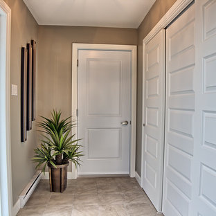 Example of a mid-sized trendy ceramic floor single front door design in Montreal with brown walls and a white front door