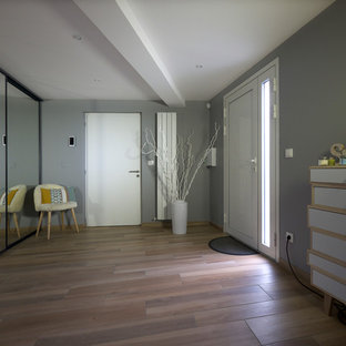 Double front door - large contemporary ceramic floor double front door idea in Angers with gray walls and a white front door