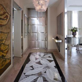 Idée de décoration pour une entrée design de taille moyenne avec un mur blanc.