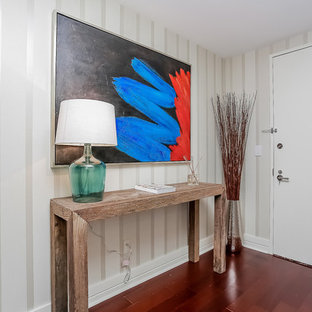 Small minimalist dark wood floor entryway photo in New York with white walls and a white front door