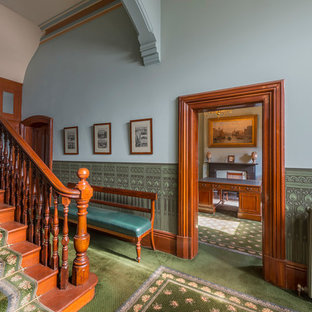 This is an example of a traditional foyer in Melbourne with blue walls and carpet.