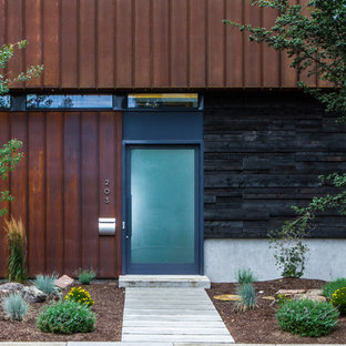 This is an example of an industrial front door in Seattle with a glass front door.
