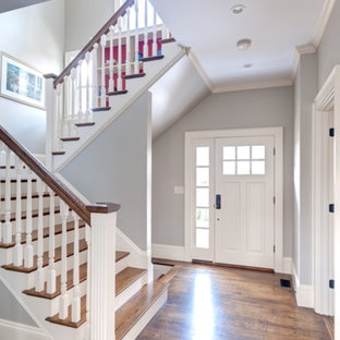 Inspiration for a large transitional medium tone wood floor entryway remodel in Boston with gray walls and a white front door