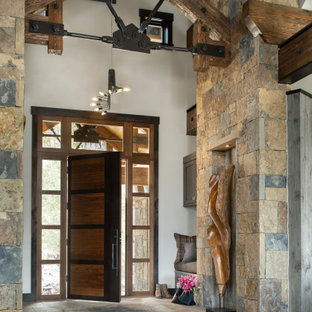 Inspiration for a rustic entryway remodel in Denver with white walls and a dark wood front door