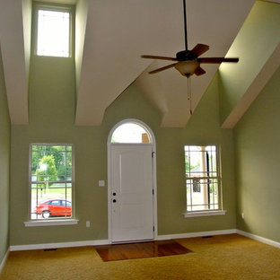 Entryway - mid-sized transitional yellow floor entryway idea in Louisville with green walls and a white front door