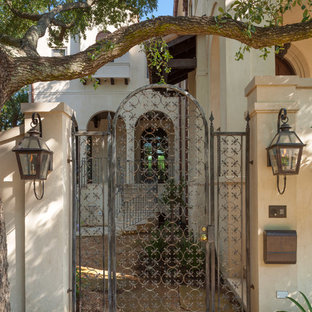 Example of a large tuscan entryway design in Houston
