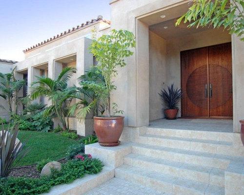 Large mediterranean limestone floor entryway idea in San Diego with a dark wood front door and & Aaw Doors | Houzz Pezcame.Com