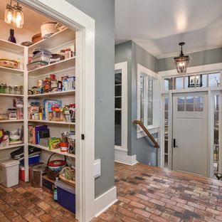 Entryway - small cottage brick floor entryway idea in Other with gray walls and a white front door