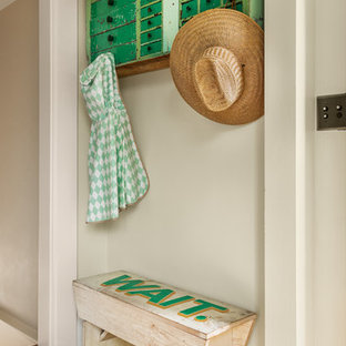 Example of a small country orange floor and light wood floor mudroom design in Portland with beige walls