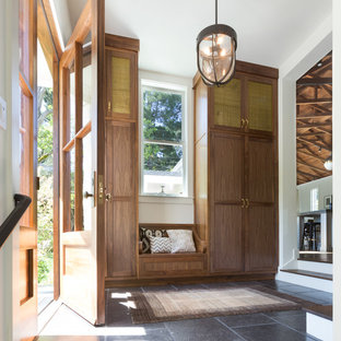 Entryway - transitional entryway idea in San Francisco with white walls and a medium wood front door