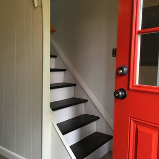 Small elegant vinyl floor entryway photo in New York with gray walls and a red front door