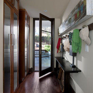 Mid-sized transitional dark wood floor and brown floor entryway photo in Atlanta with white walls and a glass front door