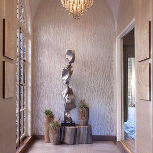 サンフランシスコの中くらいのトランジショナルスタイルのおしゃれな玄関ラウンジ (メタリックの壁、ライムストーンの床) の写真