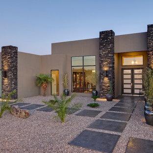 Entryway - large contemporary gray floor entryway idea in Albuquerque with brown walls and a glass front door
