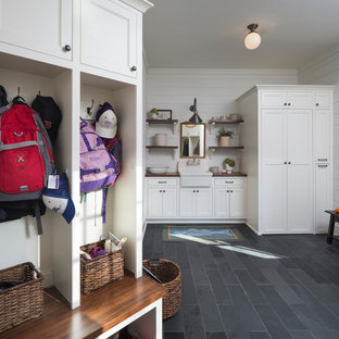 Inspiration for an eclectic gray floor mudroom remodel with white walls
