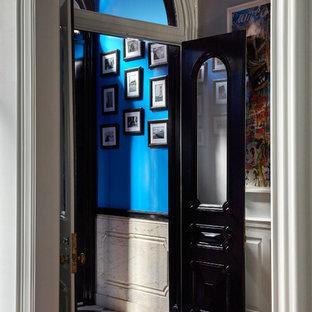 Entryway - victorian dark wood floor and brown floor entryway idea in Philadelphia with gray walls and a black front door