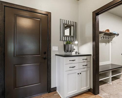 75 Trendy Craftsman Mudroom With A Brown Front Door Design Ideas
