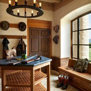 Design ideas for a rustic boot room in Indianapolis with beige walls, a single front door, a dark wood front door and beige floors.