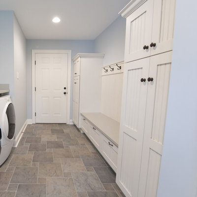 Example of a mid-sized cottage vinyl floor and multicolored floor entryway design in Other with blue walls and a white front door