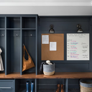 Photo of a country mudroom in Chicago with grey floor.