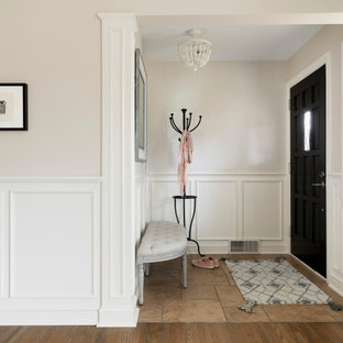 Inspiration for a small timeless porcelain floor and brown floor entryway remodel in Minneapolis with beige walls and a black front door
