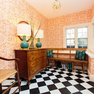 Inspiration for a transitional multicolored floor entryway remodel in Boston with orange walls and a white front door