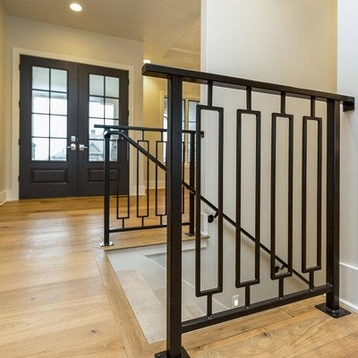 Inspiration for a mid-sized transitional light wood floor entryway remodel in Other with gray walls and a blue front door