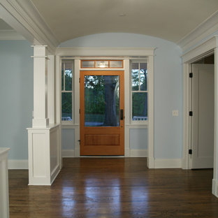 Mid-sized elegant dark wood floor entryway photo in Chicago with blue walls and a glass front door